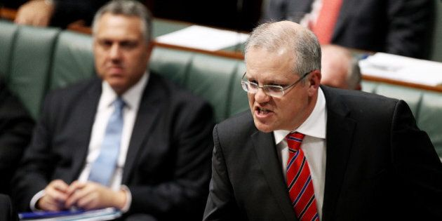 CANBERRA, AUSTRALIA - MAY 14: Minister for Immigration and Boarder Protection Scott Morrison during House...