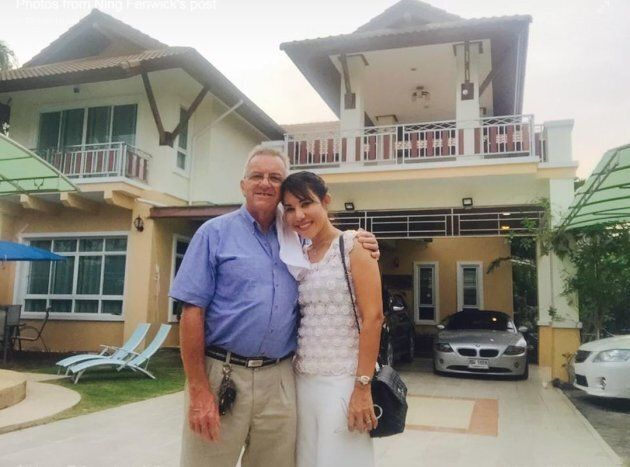 Andrew Fenwick, 66, and wife Somrudi Krailob Fenwick outside the family home in the Thai province of