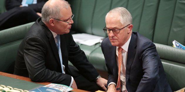 CANBERRA, AUSTRALIA - MAY 10: Treasurer Scott Morrison speaks to Prime Minister Malcolm Turnbull during...