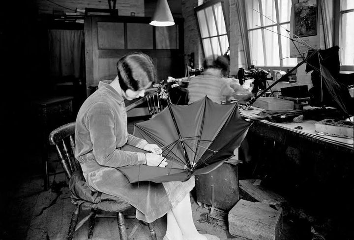 In 1934 this young woman worked at an umbrella manufacturer, sporting the Bob hairstyle that had been popular throughout the 1920s.