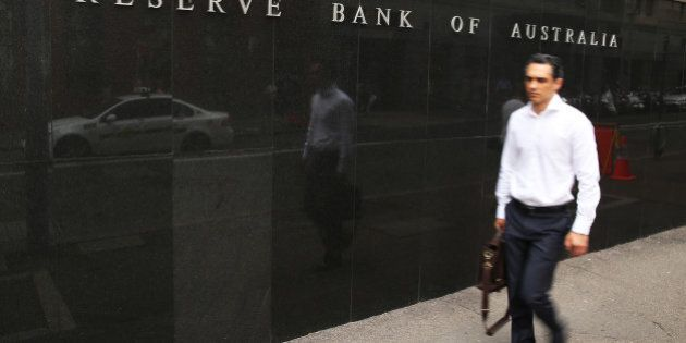 A pedestrian walk past the Reserve Bank of Australia headquarters in Sydney, Australia, on Monday, Feb....