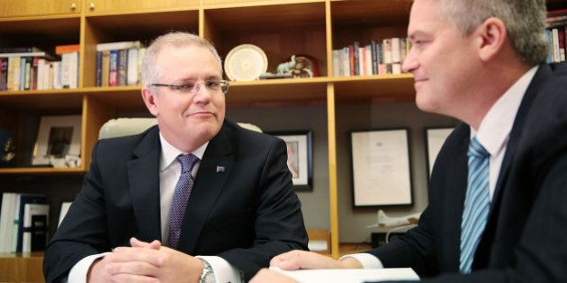 CANBERRA, AUSTRALIA - MAY 03:  Treasurer Scott Morrison and Minister for Finance Mathias Cormann pose with the 2016 Federal Budget papers in the Treasurers office at Parliament House on May 3, 2016 in Canberra, Australia. The Coalition government will deliver the 2016 federal budget tonight, and is expected to announce changes to the tax system for individuals and business as well as changes to superannuation.  (Photo by Stefan Postles/Getty Images)