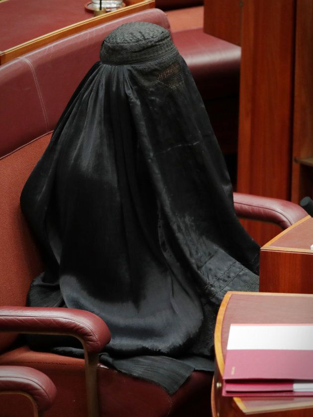 Senator Pauline Hanson wears a burqa during question time at Parliament House in Canberra on Thursday...