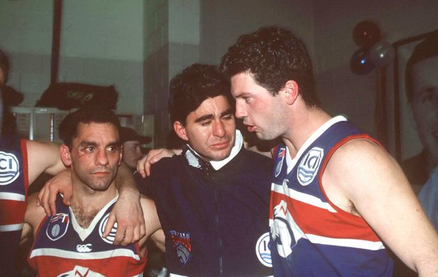Tony Liberatore, Jose Romero and Rohan Smith of the Western Bulldogs were not exactly in party mode