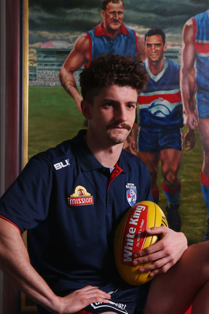 That's young Tom Liberatore with the footy, with dad Tony in the background.