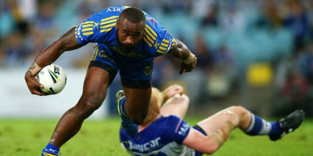 SYDNEY, AUSTRALIA - APRIL 29: Semi Radradra of the Eels runs over James Graham of the Bulldogs during...