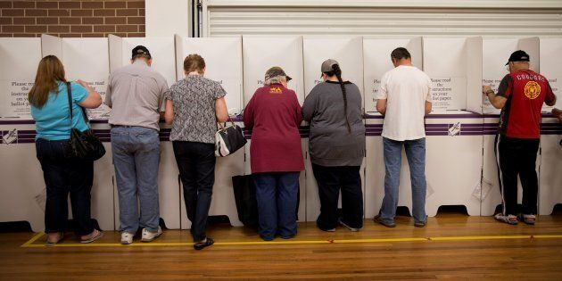 Australian have been urged to participate in the great tradition of sausage sizzle-eating (and voting)...