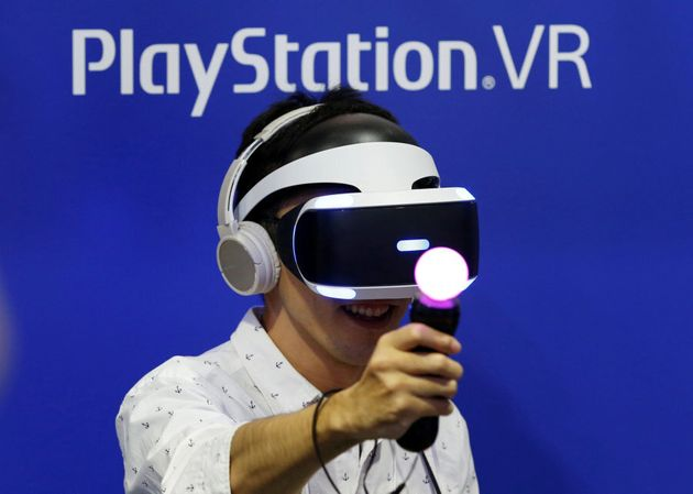 A man plays a video game with Sony's PlayStation VR headset at Tokyo Game Show 2016 in Makuhari, east...
