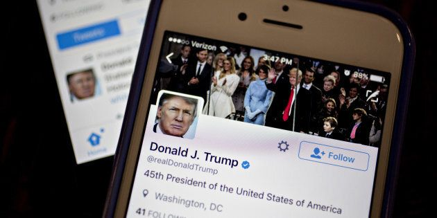 The Twitter Inc. accounts of U.S. President Donald Trump, @POTUS and @realDoanldTrump, are seen on an Apple Inc. iPhone.