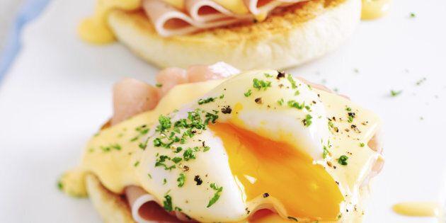 Eggs Benedict Sandwiches Served on Porcelain Board. Selective Focus, Shallow DOF, Tilt&Shift Lens Used