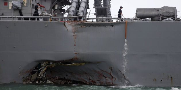 The U.S. Navy guided-missile destroyer USS John S. McCain is seen after a collision, in Singapore waters...