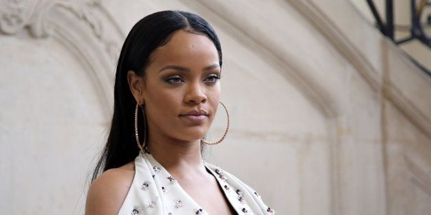 Singer Rihanna poses for photographers as she arrives to Christian Dior's Spring-Summer 2017 ready-to-wear fashion collection presented in Paris, Friday, Sept. 30, 2016. (AP Photo/Thibault Camus)