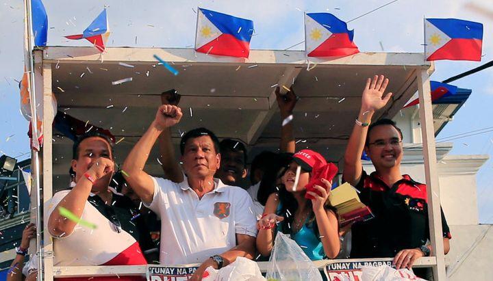 Rodrigo Duterte rides a motorcade through capital Manila.