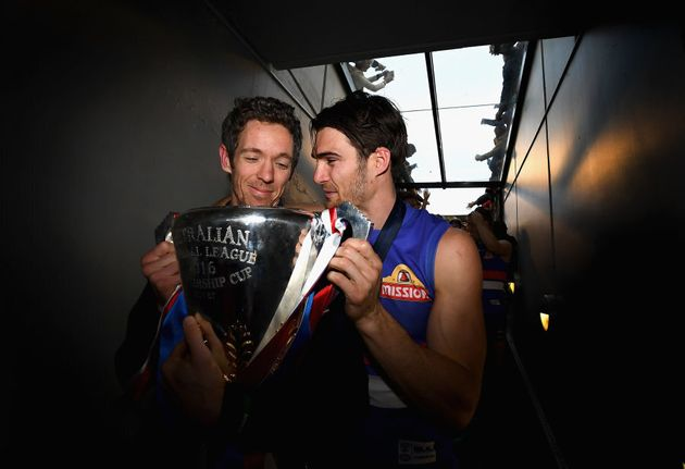 Skipper and skipper. Murphy and Wood share a quiet moment with the premiership
