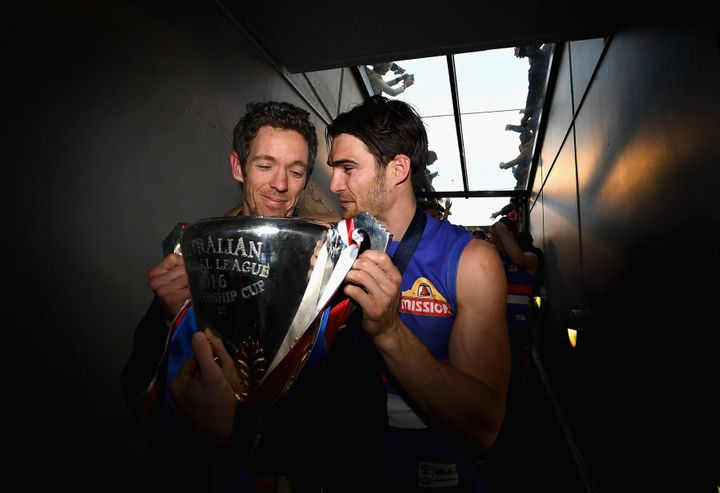 Skipper and skipper. Murphy and Wood share a quiet moment with the premiership cup.