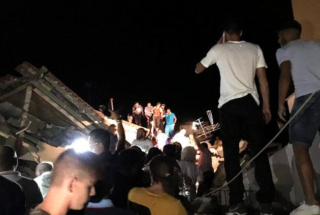 People are rescued from damaged buildings in Ischia. One person is dead and seven more are still missing.