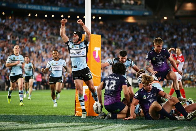 Michael Ennis is pretty happy that somewhere in that pile of humanity, Andrew Fifita has planted the...