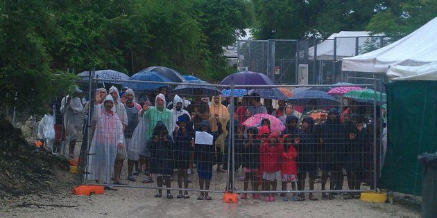 Protesters stand outside Nauru detention centre in April.