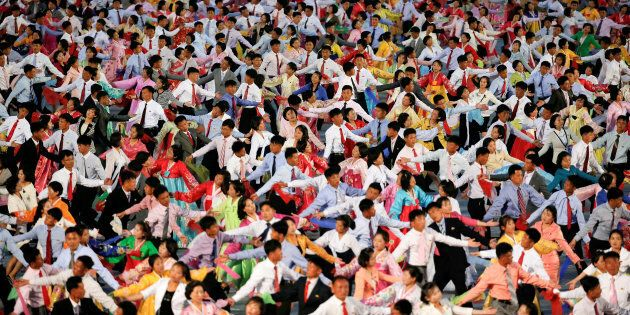 People participate in a mass dance in the capital's main ceremonial square, a day after the ruling Workers' Party of Korea party wrapped up its first congress in 36 years, in Pyongyang, North Korea, May 10, 2016. REUTERS/Damir Sagolj