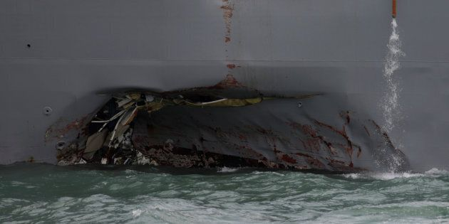 The U.S. Navy guided-missile destroyer USS John S. McCain is seen after a collision, in Singapore