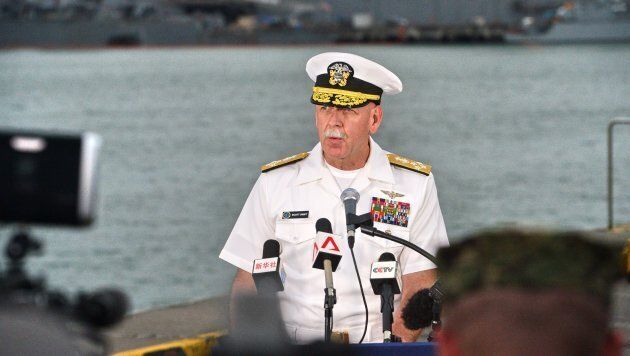 Admiral Scott Swift, commander of the U.S. Pacific Fleet, speaks to reporters during a press conference, as the guided-missile destroyer USS John S. McCain is seen in the background, at Changi naval base in Singapore.