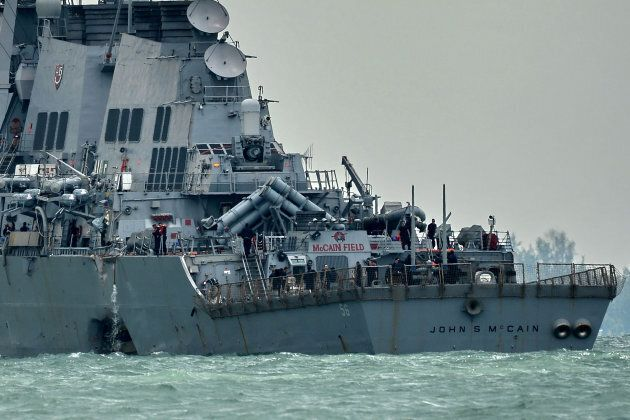 The guided-missile destroyer USS John S. McCain, with a hole on its portside after a collision with an oil tanker.