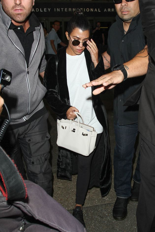 Kourtney Kardashian is seen at LAX, returning home on October