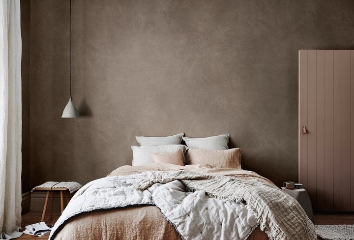 Styled by Bree Leech and Heather Nette King for Dulux Colour Trends 2017, this room features Dulux Suede Effect Macchiato Malt and door in Pragmatic. Curtain and bedlinen, from Throw Hale Mercantile & Co, Leather cushion on bed from Designstuff, and side table from Cult.