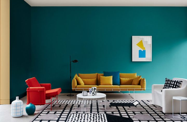 Styled by Bree Leech and Heather Nette King for Dulux Colour Trends 2017, this living room features Dulux Deep Arctic and the wall return in Hay Wain. the red chair if from Cult, rug and sofa from Living Edge and floor lamp from Ajar.
