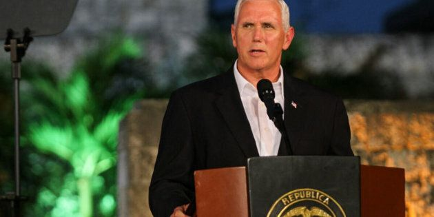 US Vice President Mike Pence speaks during a joint press conference with Colombian President Juan Manuel Santos (not in frame) at the Presidential guest house in Cartagena, Colombia on August 13, 2017. Pence launches a Latin America tour that has taken on new significance following President Donald Trump's threat of a possible 'military option' against Venezuela. The weeklong trip, aimed at coordinating a regional diplomatic action to the political crisis in Caracas, begins in Colombia and also includes Argentina, Chile and Panama. / AFP PHOTO / STR (Photo credit should read STR/AFP/Getty Images)