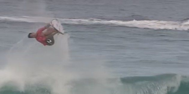 Gabriel Medina backflips on a wave and yes, he lands