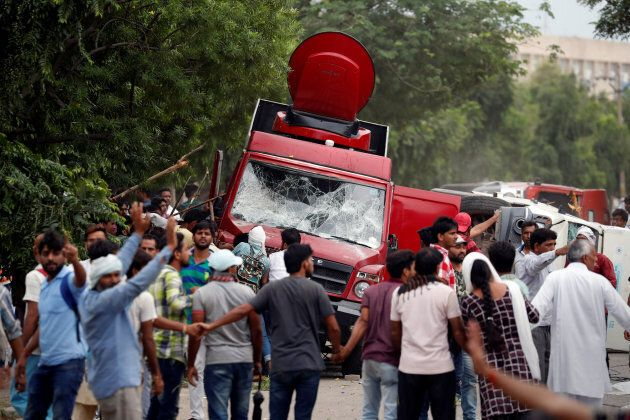 Rioters smash television trucks during violence in Panchkula, India.