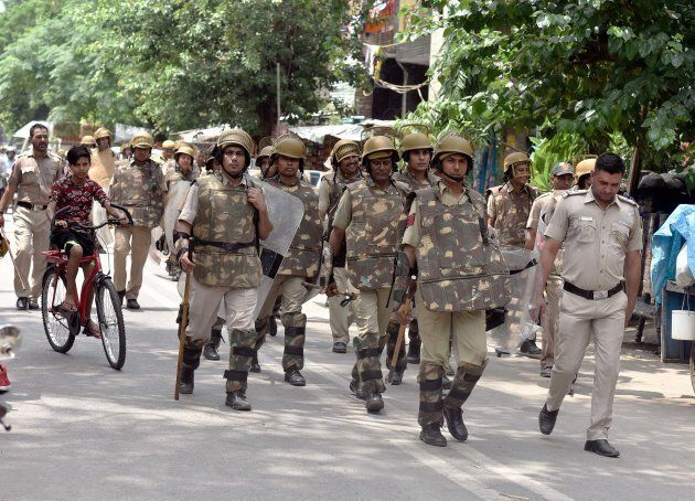 Delhi Police personnel patrolling amid tightened security.
