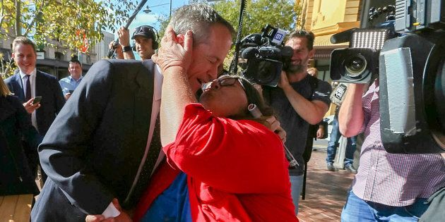 Bill Shorten receives one of two kisses from Margot