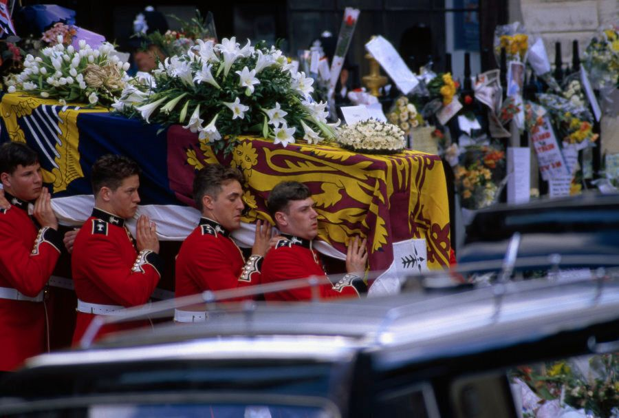 Diana's casket is carried from Westminster