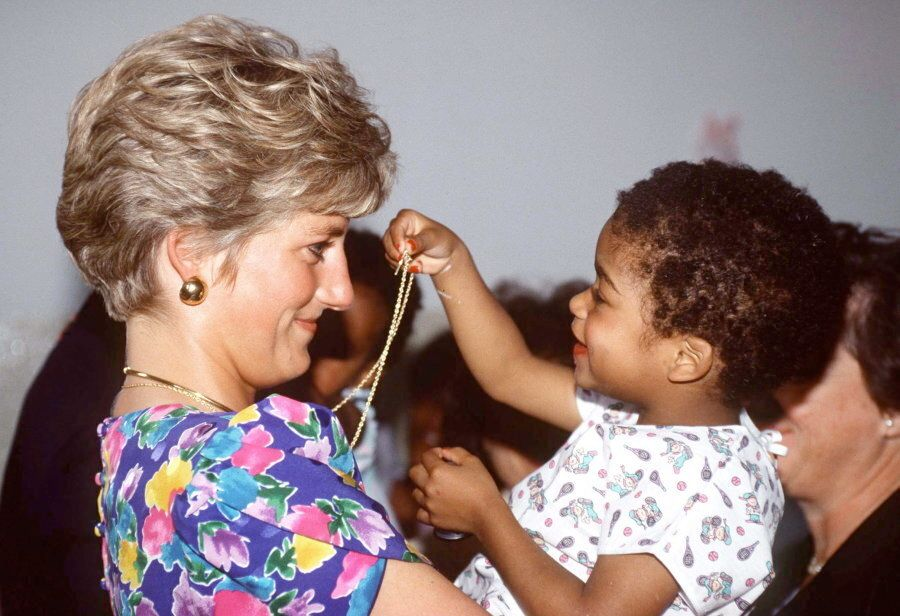Diana holding a baby at a hostel for abandoned children In Sao Paolo, Brazil. The Hostel Cares for HIV-Positive