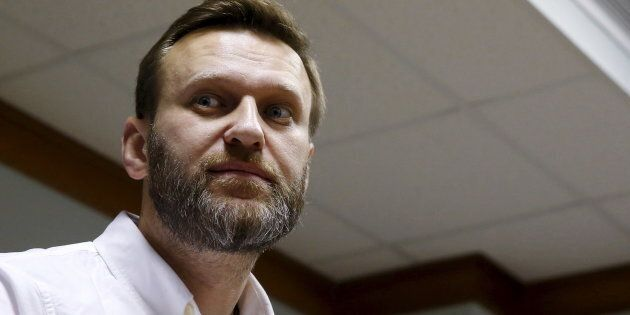 Russian anti-corruption campaigner Alexei Navalny and fellow activists were attacked at an airport by assailants described as Cossacks.