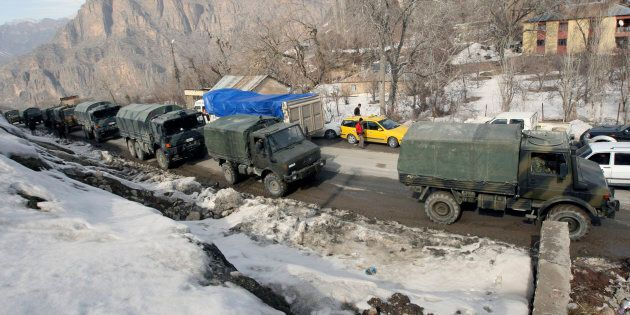 A Turkish military convoy arrives in the south-eastern Turkish border town of Cukurca, bordering Iraq, February 29, 2008. Turkey's military General Staff said on Friday that its troops had returned to bases in Turkey after a major ground offensive against Kurdish PKK rebels in northern Iraq.  REUTERS/Fatih Saribas  (TURKEY)