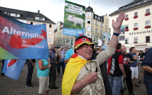 Alternative for Germany party supporters protest during the election rally of the German Chancellor Angela...