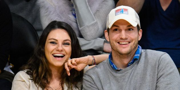 LOS ANGELES, CA - DECEMBER 19: Mila Kunis (L) and Ashton Kutcher attend a basketball game between the Oklahoma City Thunder and the Los Angeles Lakers at Staples Center on December 19, 2014 in Los Angeles, California. (Photo by Noel Vasquez/GC Images)