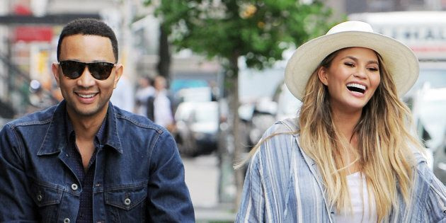 NEW YORK, NY - MAY 14: John Legend and Chrissy Teigen with new born Luna out for a long walk home after lunch at Il Buco in East Village on May 14, 2016 in New York, NY. (Photo by Josiah Kamau/BuzzFoto via Getty Images)