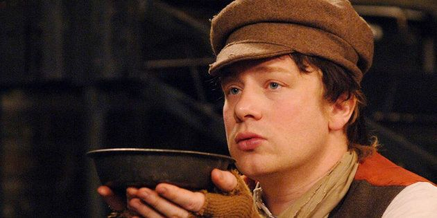You want MORE?! Jamie Oliver plays Oliver Twist for a sketch for the Friday Night Project, at the London...