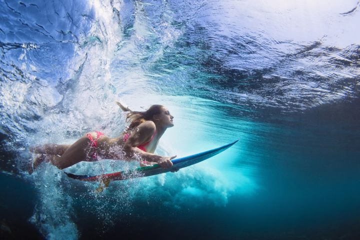 Activities like surfing and stand up paddle boarding are so fun they don't feel like exercise.