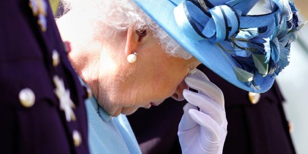 Queen Elizabeth II sheds a tear at an unveiling of a new memorial.