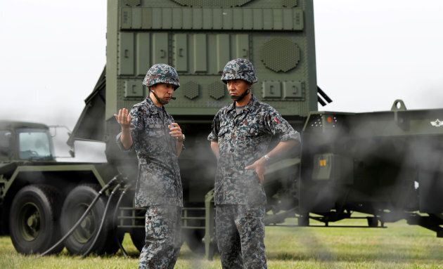 Japan Self-Defense Forces soldiers take part in a drill to mobilise their Patriot Advanced Capability-3...