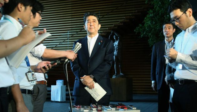 Japanese Prime Minister Shinzo Abe speaks to the media at his official residence in Tokyo on August