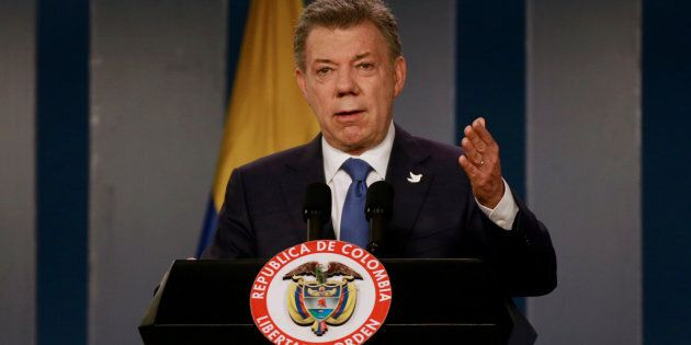 Colombia's President Juan Manuel Santos talks during a news conference after a meeting with Colombian...