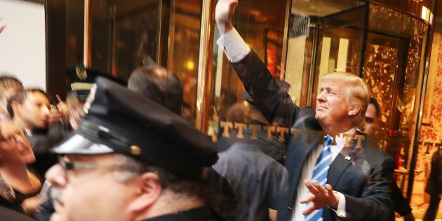 Donald Trump greets supporters outside of Trump Towers in Manhattan October 8, 2016 in New York City.