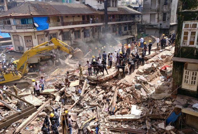 Building Collapse After Torrential Rains Kills At Least 22 In