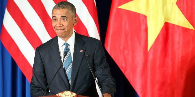 President Barack Obama in a dark navy suit. You probably didn't even notice his limited colour